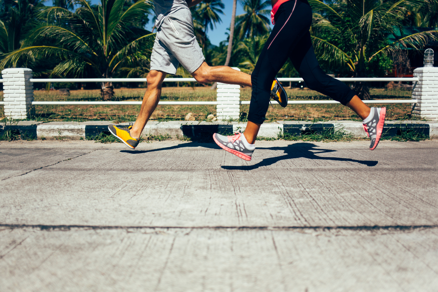 Sporty couple jogging together on a hot summer day.
