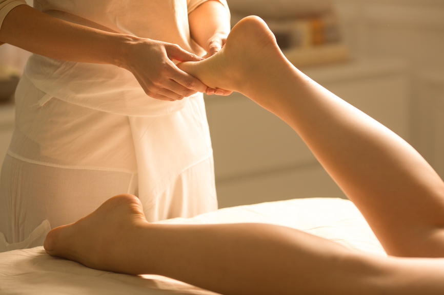 Foot massage at a spa centre.